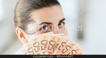 woman hiding her face behind euro money fan stock photo, business, finance, saving, banking and people concept - close up of woman hiding her face behind euro money fan by Syda Productions