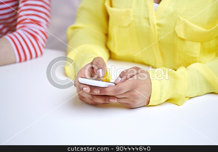 close up of female hands with smartphone stock photo, people, technology and internet concept - close up of african american teenage girl hands with smartphone by Syda Productions