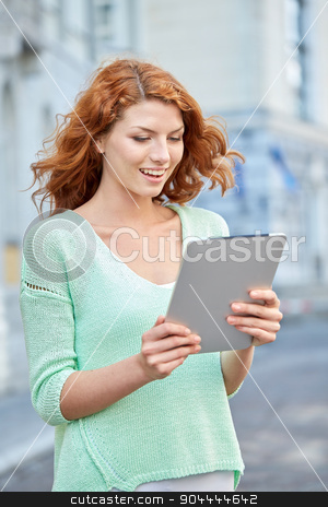 smiling teenage girl with tablet pc on city street stock photo, tourism, travel, leisure, people and technology concept - smiling redhead teenage girl or young woman with tablet pc on city street by Syda Productions