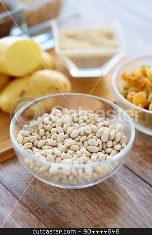 close up of beans in glass bowl on table stock photo, protein diet, cooking, culinary and food concept - close up of beans in glass bowl on table by Syda Productions
