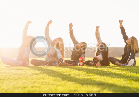 Sporty women stretching during fitness class stock photo, Sporty women stretching during fitness class in parkland by Wavebreak Media