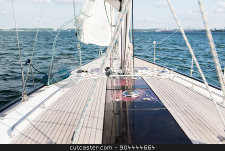close up of sailboat or sailing yacht deck and sea stock photo, vacation, travel, cruise and leisure concept - close up of sailboat or sailing yacht deck and sea by Syda Productions