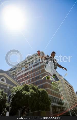 Athletic man doing parkour in the city stock photo, Athletic man doing parkour in the city on a sunny day by Wavebreak Media