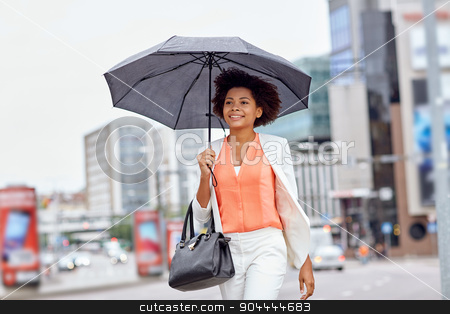 happy african american businesswoman with umbrella stock photo, business and people concept - young smiling african american businesswoman with umbrella and handbag walking down city street by Syda Productions