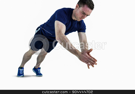 A fit man doing clapping hands push ups stock photo, A fit man doing clapping hands push ups on a white background by Wavebreak Media