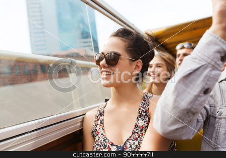 teenage girl with friends traveling by tour bus stock photo, travel, tourism, summer vacation, sightseeing and people concept - happy teenage girl in sunglasses with group of friends traveling by tour bus by Syda Productions