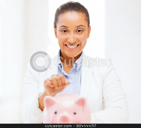 woman with piggy bank and coin stock photo, banking and finances concept - picture of lovely woman with piggy bank and cash money by Syda Productions