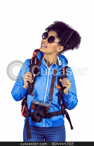 A tourist with a backpack and camera stock photo, A tourist with a backpack and camera on a white background by Wavebreak Media