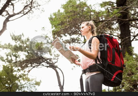 Blonde hiker with map searching for path  stock photo, Blonde hiker with map searching for path in the nature by Wavebreak Media