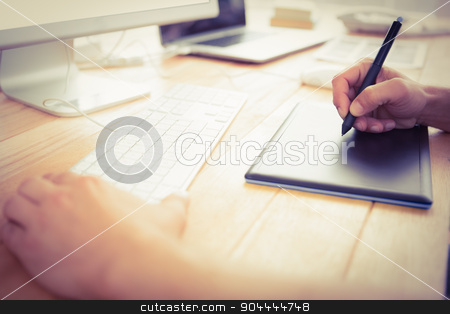 Graphic designer working with digitizer stock photo, Graphic designer working with digitizer in the office by Wavebreak Media