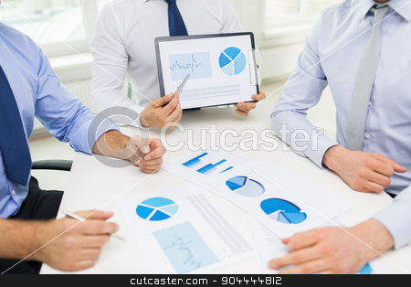 close up of businessman hands with clipboard stock photo, business, people, statistics and teamwork concept - close up of businessman hands with clipboard pointing pen to chart at office by Syda Productions