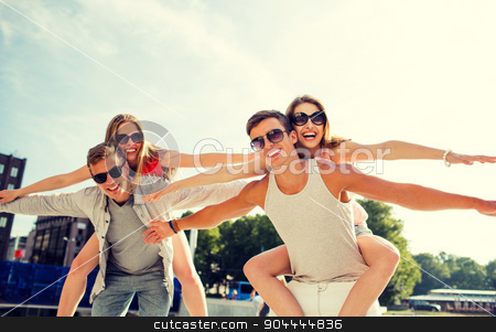 smiling couple having fun in city stock photo, holidays, vacation, love and friendship concept - smiling couple having fun in city by Syda Productions