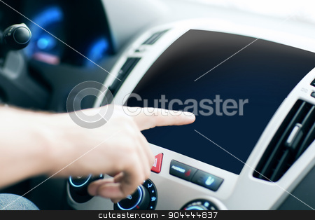 male hand pointing finger to monitor on car panel stock photo, transport, modern technology and people concept - male hand pointing finger to black blank monitor on car panel by Syda Productions