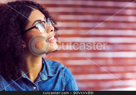 Casual businesswoman day dreaming  stock photo, Casual businesswoman day dreaming at the office  by Wavebreak Media