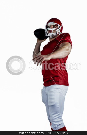 American football player throwing ball stock photo, American football player throwing ball on white background by Wavebreak Media