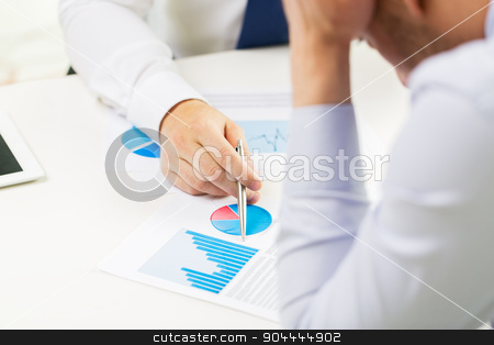 close up of businessman hands with chart stock photo, business, people, statistics and fail concept - close up of businessman hands showing chart to other anxious man man at office by Syda Productions