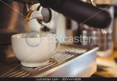 Machine making a cup of coffee stock photo, Machine making a cup of coffee in a cafe by Wavebreak Media