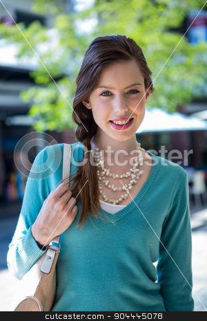 Brunette smiling at camera in mall stock photo, Brunette smiling at camera in mall on a sunny day by Wavebreak Media