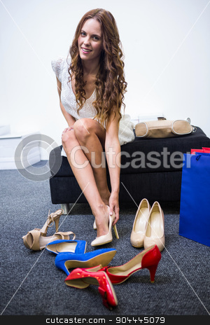 Woman trying on different shoes stock photo, Woman trying on different shoes at the shopping mall by Wavebreak Media