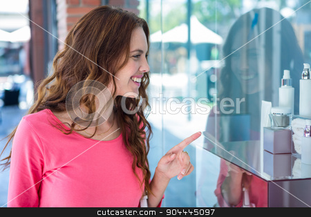 Pretty woman shopping for make up stock photo, Pretty woman shopping for make up at the pharmacy by Wavebreak Media