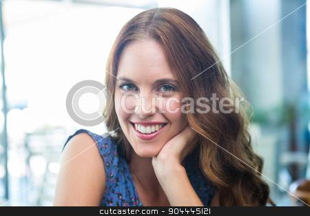 Pretty brunette smiling at camera stock photo, Pretty brunette smiling at camera in a coffee shop by Wavebreak Media