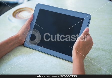Woman using tablet on cafe terrace stock photo, Woman using tablet on cafe terrace on a sunny day by Wavebreak Media