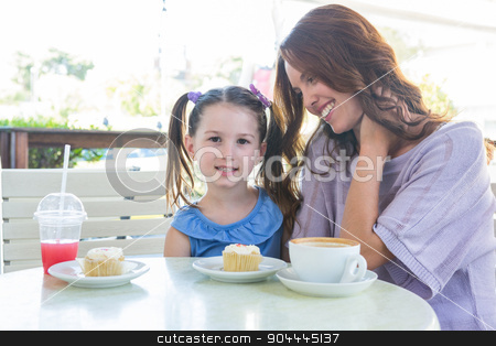 Mother and daughter enjoying cakes at cafe terrace stock photo, Mother and daughter enjoying cakes at cafe terrace on a sunny day by Wavebreak Media