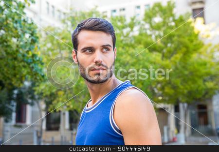 Handsome athlete looking away stock photo, Handsome athlete looking away in the city by Wavebreak Media