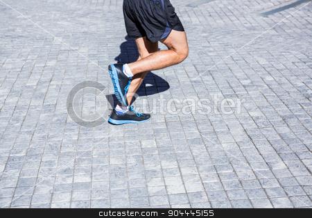 Athletes legs running stock photo, Athletes legs running in the city by Wavebreak Media