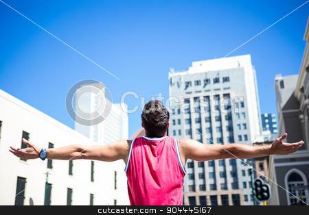 Handsome athlete enjoying the sun stock photo, Handsome athlete enjoying the sun on a beautiful day by Wavebreak Media