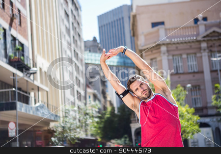 Handsome athlete doing arms stretching stock photo, Handsome athlete doing arms stretching on a sunny day by Wavebreak Media