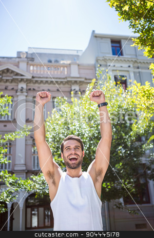 Handsome athlete gesturing victory stock photo, Handsome athlete gesturing victory with arms raised by Wavebreak Media