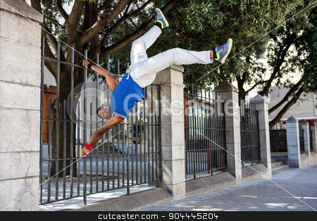 Extreme athlete jumping in front of building stock photo, Extreme athlete jumping in front of building in the city by Wavebreak Media