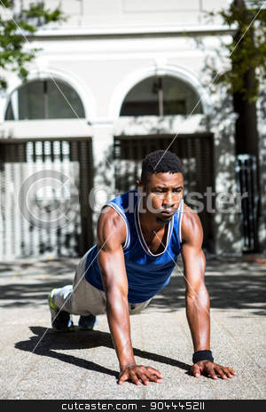 Happy athlete doing push-ups stock photo, Happy athlete doing push-ups on the street  by Wavebreak Media