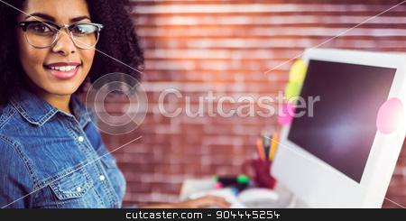 Casual female designer smiling stock photo, Portrait of casual female designer smiling against red brick background by Wavebreak Media