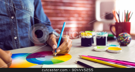 Graphic designer drawing on colour chart  stock photo, Graphic designer drawing on colour chart at workplace by Wavebreak Media