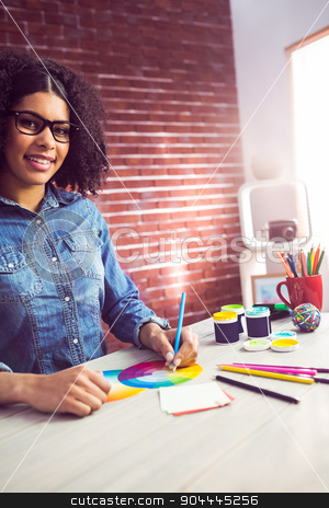 Casual female designer smiling and drawing stock photo, Portrait of casual female designer smiling and drawing at workplace by Wavebreak Media