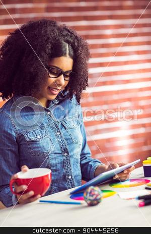 Casual businesswoman on a coffee break stock photo, Casual businesswoman on a coffee break in her office by Wavebreak Media