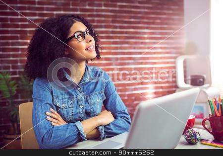Casual businesswoman day dreaming  stock photo, Casual businesswoman day dreaming at the office  by Wavebreak Media