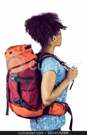 Young woman with backpack stock photo, Young woman with backpack against a white background by Wavebreak Media