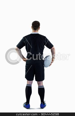 Rugby player holding a rugby ball stock photo, Back view of a rugby player holding a rugby ball by Wavebreak Media
