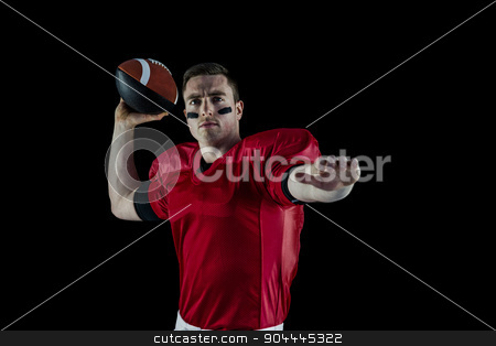 American football player about to throw the ball stock photo, Portrait of an american football player about to throw the ball by Wavebreak Media