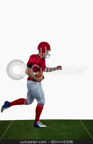 American football player running with football stock photo, American football player running with football on american football field by Wavebreak Media