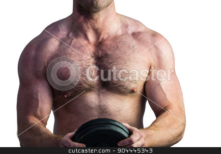 Strong bodybuilder holding a weight stock photo, Strong bodybuilder holding a weight on white background by Wavebreak Media