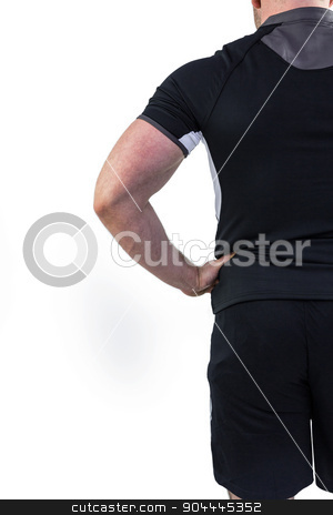 Rugby player with hand on hip stock photo, Rugby player with hand on hip on white background by Wavebreak Media