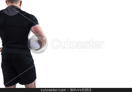 Rugby player holding the ball stock photo, Rugby player holding the ball on white background by Wavebreak Media