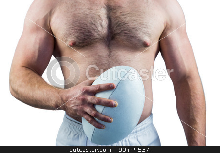 Shirtless rugby player holding ball stock photo, Shirtless rugby player holding ball on white background by Wavebreak Media