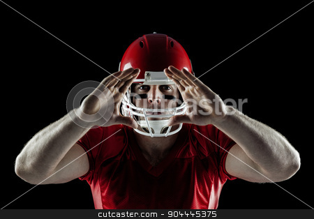 American football player making hand gesture stock photo, American football player making hand gesture on black background by Wavebreak Media