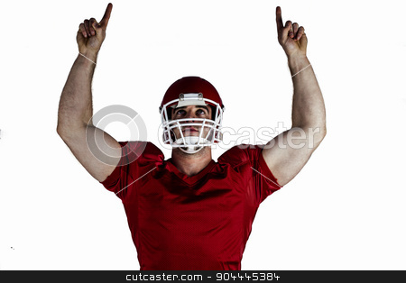 American football player cheering stock photo, American football player cheering on white background by Wavebreak Media