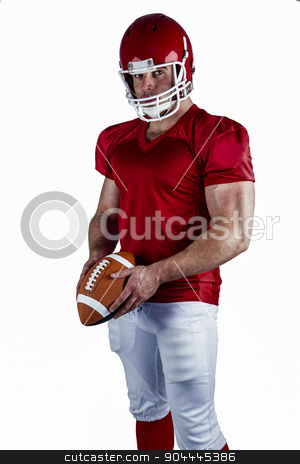American football player holding ball stock photo, American football player holding ball on white background by Wavebreak Media